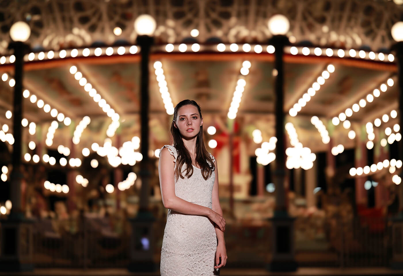 Model in front of carousel taken using RF 85mm f/1.2L USM DS prime lens