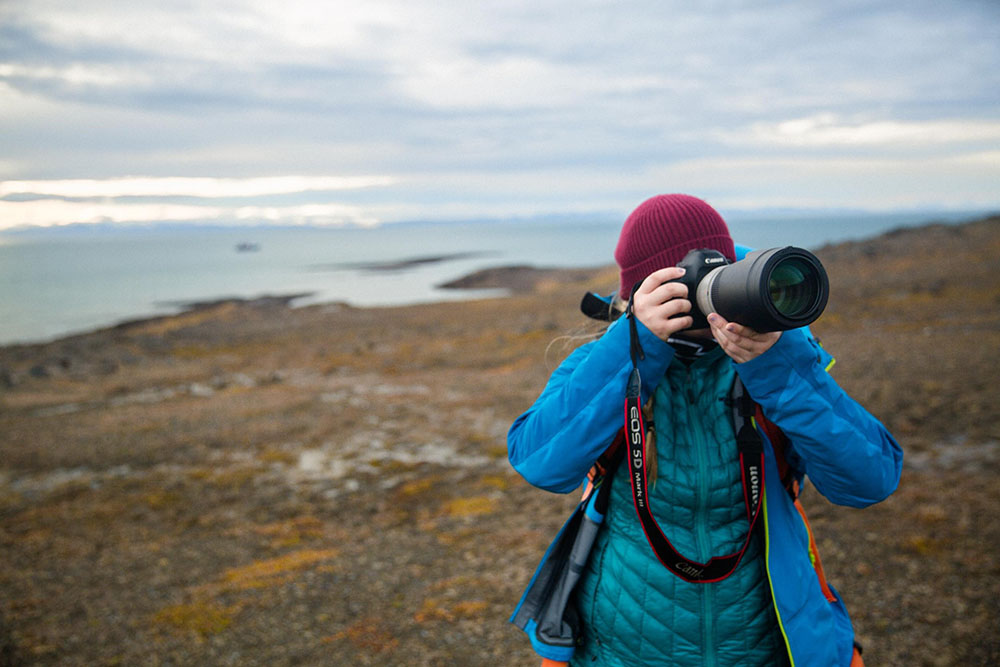 Portrait image of Liz Carlson photographing in the artic