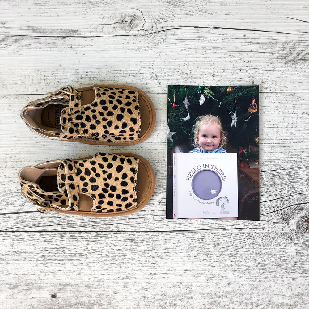 Children's pair of shoes and printed photo of child
