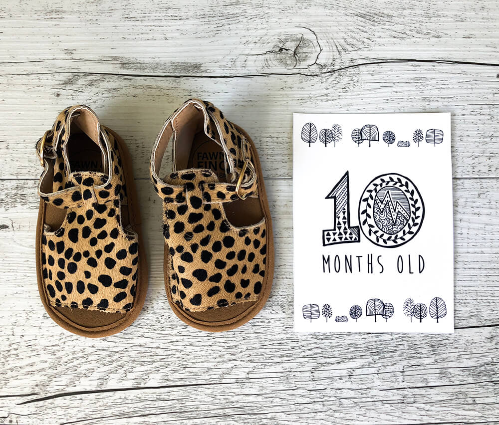 Children's shoes and printed 10 months old card