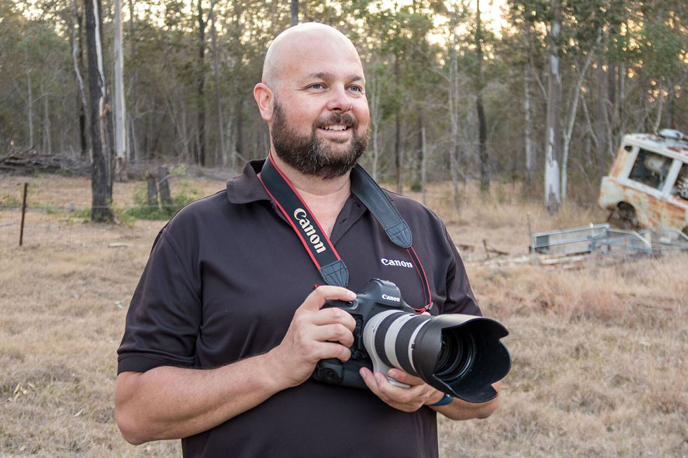 portrait image of greg photographing