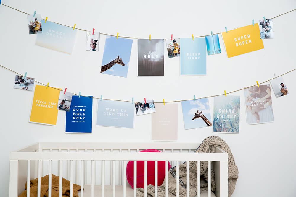DIY nursery decoration - images pegged on string in baby room
