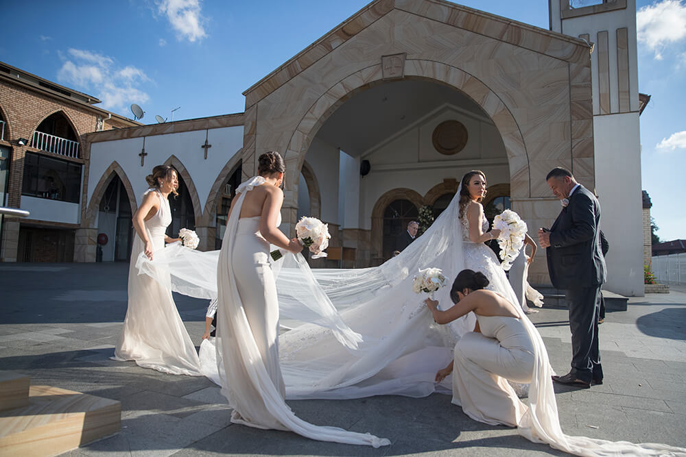 Bridesmaids outside church photo by Canon Master Ryan Schembri