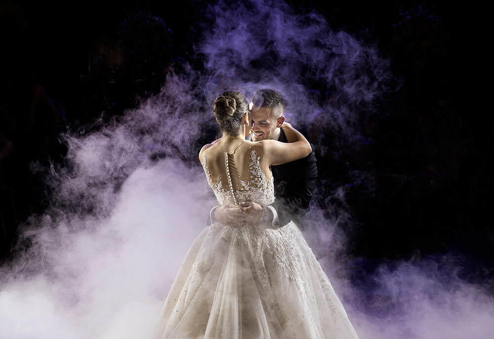 Bride and groom dancing in fog photo by Canon Master Ryan Schembri