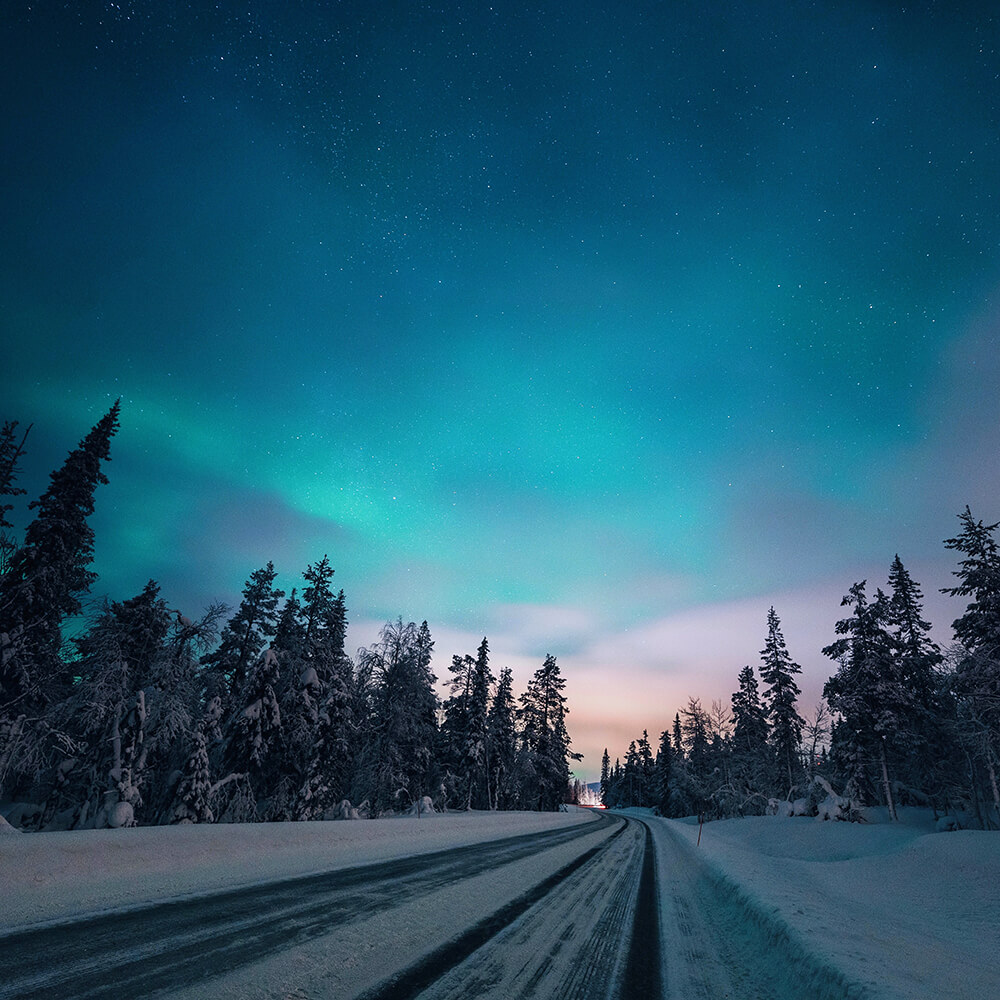 Photo of a highway under the Aurora in Finland. Shot by Elaine Li