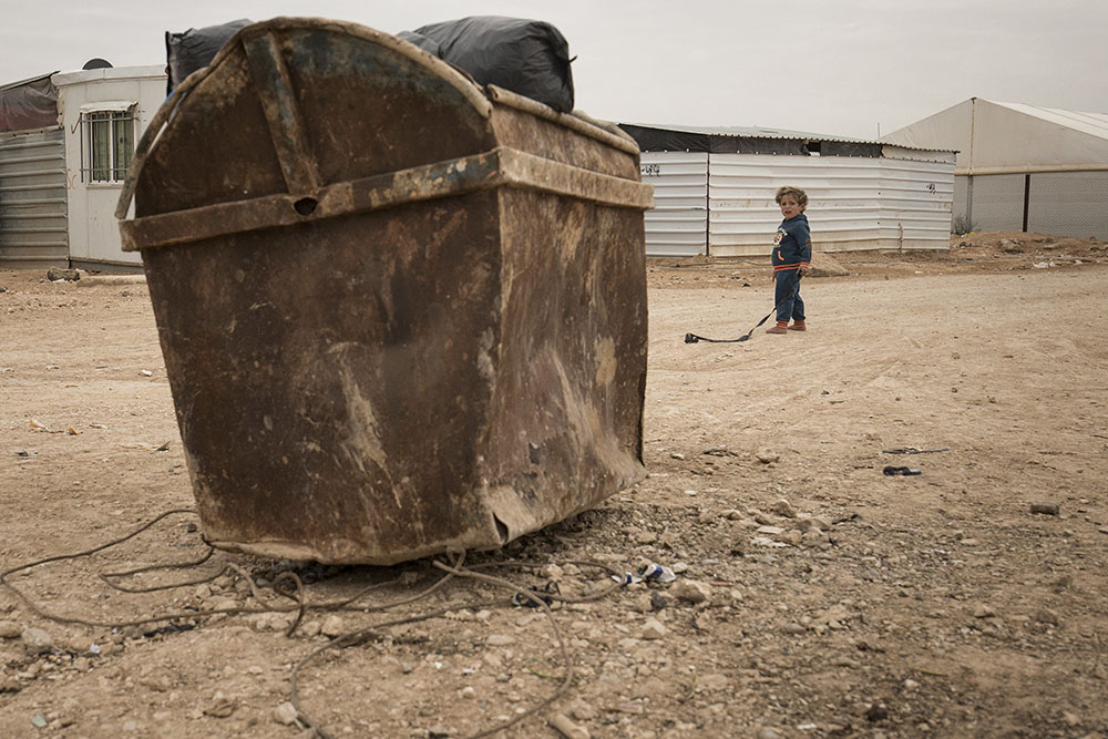 Lsnadscape image of kid in refugee camp