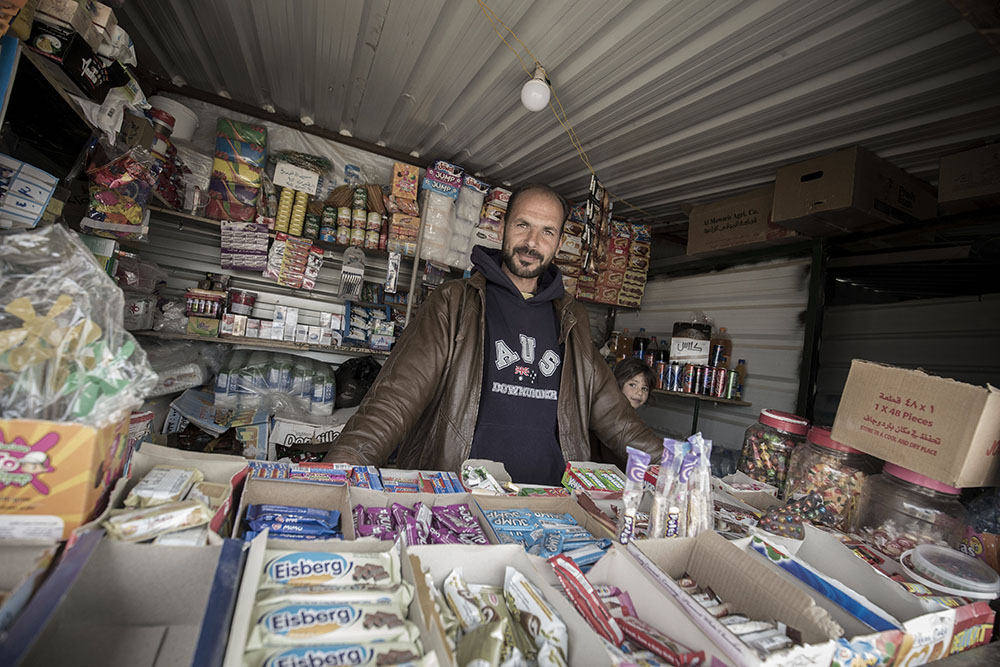 image of man in his shop in refugee camp
