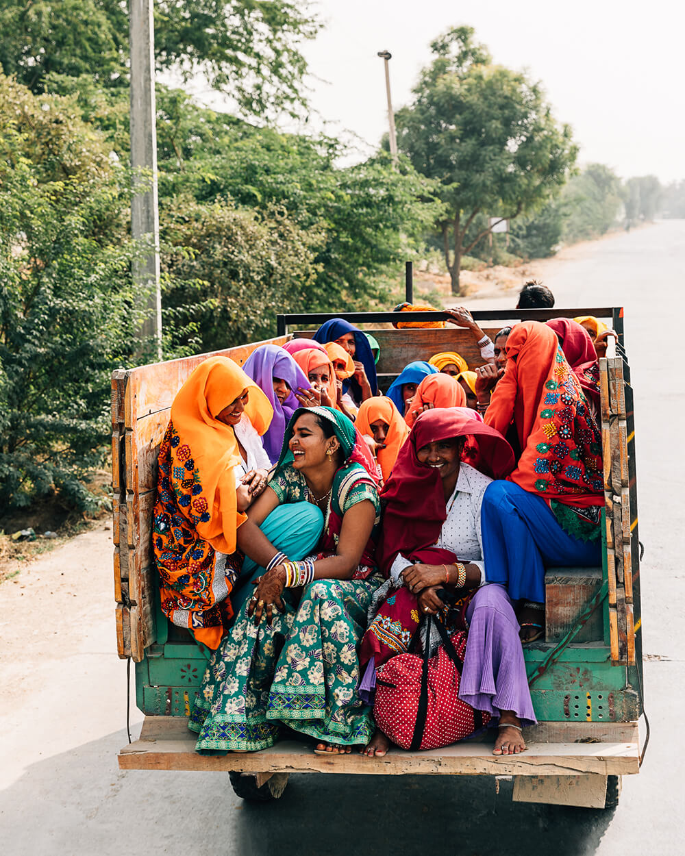 A group of Indian women on the back of a truck. Shot by Melissa Findley