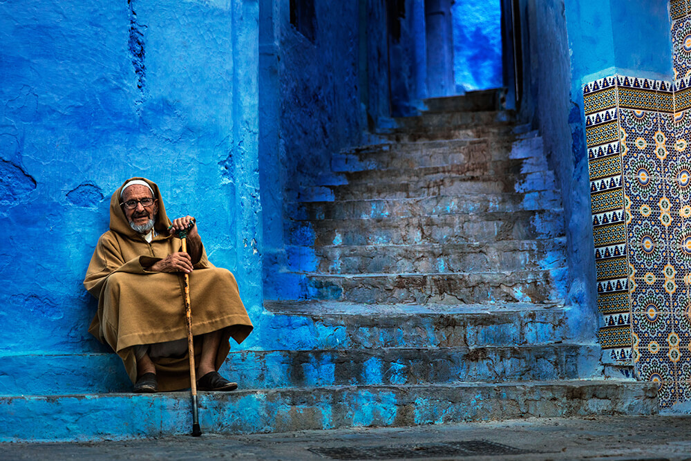 A Moroccan local next to a stair. Image by Brook Rushton